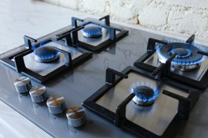 Cooktop with burning gas ring. Gas cooker with blue flames